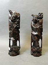 A pair of Japanese carved wood figures inlaid with