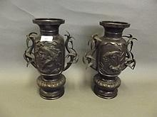 A pair of Japanese bronze twin handled vases with