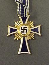 A German 1938 gold crucifix in an R. Hanschild Pforzheim box, 1¾'' long
