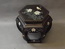A hexagonal black lacquered Oriental plant stand decorated with birds and flowers, 19'' high