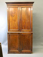 A Victorian mahogany bookcase cupboard with four panelled doors, 41½'' x 18½'', 82½'' high