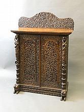 A C19th Burmese pierced and carved hardwood two door side cabinet flanked by pillars, on lion feet, 32'' x 13½'', 45½'' high