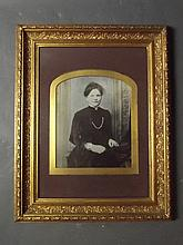 A Victorian gilt framed overpainted photograph of a lady, 24'' x 19½''