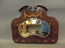 A Victorian inlaid mahogany and brass mounted shaped wall mirror, 22'' x 18''