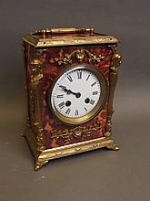 A faux tortoiseshell and brass cased mantle clock, 7'' x 5¼'', 8¾'' high