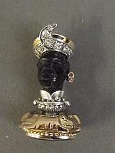 A 9ct gold seal in the form of a Blackamoor set with diamonds, 1¾'' long