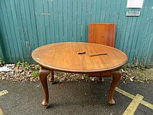 A walnut oval wind out dining table with an extra leaf, 71'' x 42'' extended, 29'' high