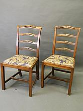 A set of ten solid beech pierced ladder back dining chairs with drop in seats