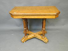 A C19th carved and inlaid oak card table in the gothic revival style, previously retailed by Liberty, 36'' x 18'', 29'' high