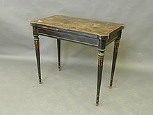 A C19th French ebonised fold over card table with inlaid decoration and brass mounts, 33½'' wide, 20'' deep (AF)