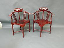 A pair of Chinese carved rosewood corner elbow chairs with Mother of Pearl inlaid decoration
