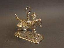 A silver plated cruet set in the form of a dog carrying a bucket and pot, 5¼'' high