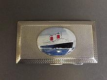 A silver engine turned cigarette case with later applied decorative plaque depicting an ocean liner, Birmingham 1926, 3½'' x 2''