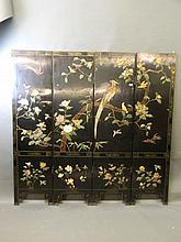 An early C20th Chinese lacquered four fold screen inlaid with hardstones depicting exotic birds and flowers, 72½'' high, 73'' wide