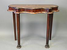 A shaped mahogany hall table on column supports with flared feet, 38'' x 13½'' high, 30½'' high