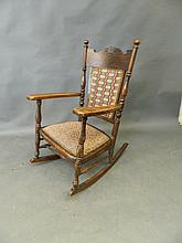 A Victorian carved oak rocking chair