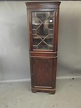 A C19th mahogany astragal glazed standing corner cupboard, 72'' high, Best Bid