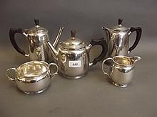 A five piece Hallmarked silver Arts & Crafts style tea/coffee service, Birmingham 1963/64, maker D.J.L., total weight 2181g, 6¼'' high