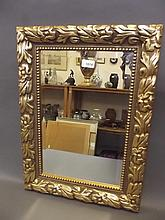 A decorative gilt wall mirror, 23'' x 16½''