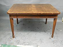 An early C20th walnut drawleaf dining table on square tapering supports, with two extra leaves, 50½'' x 41½'', 30'' high, Best Bid