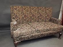 A Georgian style walnut framed settee on shell carved walnut cabriole supports, 72'' wide