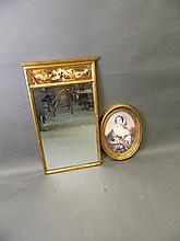 An oval gilt framed picture, girl in a scarf, and a large gilt framed hall mirror with a painted frieze depicting fruit and flowers, 31'' x 17''