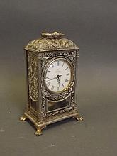 An ornate gilt metal mantle clock on pawed feet supports, 4'' x 3'', 6½'' high