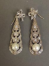 A pair of 9ct gold and silver drop earrings set with pearls