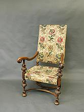 A large carved walnut Carolean style armchair, c1900