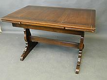 An Ercol oak drawleaf dining table, 45'' x 28'', 29½'' high