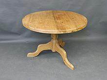 A pine circular kitchen table on turned supports, 65½'' x 38'', 29'' high
