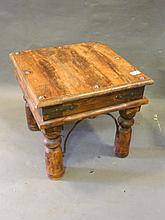 An Eastern teak and iron bound occasional table, 18'' square, 16'' high