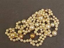 A fine pearl necklace made of honey coloured South Sea pearls, of various sizes and diamond spacers, 52'' long