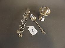 A good pair of Hallmarked silver sugar tongs, a Hallmarked silver egg cup, and a Hallmarked silver spoon, 82g