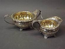 A Hallmarked Georgian silver twin handled bowl and matching jug, with releif foliate decoration, London 1822/23, marker 'R.E.E.B., Rebecca Emes & Edward Barnard', 700g