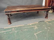A large Eastern hardwood iron bound low table, 63'' x 34'', 18'' high