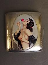 A silver engine turned cigarette case with later applied decorative plaque of a topless woman holding a flower, Birmingham 1924, 3¼'' square