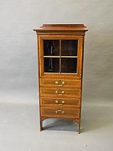 An Edwardian inlaid mahogany cabinet with drawers below, 20½'' x 14¾'', 46½'' high