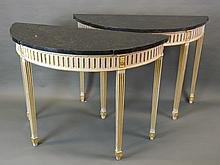 A pair of painted and gilt demi-lune console tables with fluted legs and paterae decoration, with shaped granite tops, 47'' x 20'', 34'' high