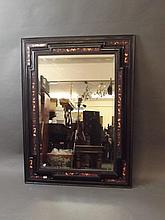 A Dutch ebonised wood and faux tortoiseshell mirror, 35'' x 47''