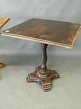An early C20th oak pub table on a twist pedestal support, 27'' square, 28½'' high