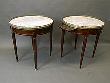 A pair of Louis XV style circular occasional tables with marble tops and pierced galleries, with two drawers and two slides, on fluted tapering supports, 26'' diameter, 29'' high