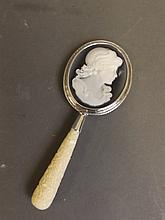 A 925 silver and composition cameo hand mirror with carved floral decoration to handle, 4¾'' long