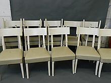 A set of fourteen contemporary painted bar back dining chairs with studded leather seats