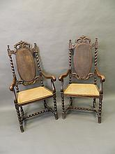 A pair of C19th Carolean style carved oak elbow chairs