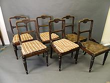 A set of six Regency carved faux rosewood dining chairs with cane seats, on reeded supports