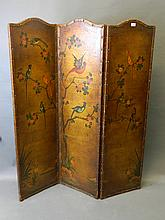 A C19th leather three fold screen painted with exotic birds amongst flowering trees, 61'' high, 51'' wide