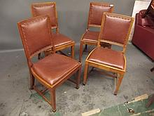 A set of 4 Art Deco walnut side chairs upholstered in brown leather, by Melson Brothers, London