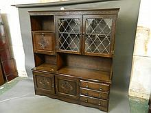 A large mid C20th carved oak and leaded light three door side cabinet, 64'' x 18'', 69½'' high, Best Bid