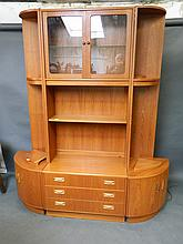 A G-plan teak three section dining room cabinet in the form of two corner cupboards and a central section, 62'' x 16½'', 78'' high, Best Bid